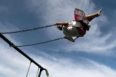 15155571-girl-swinging-high-in-the-air